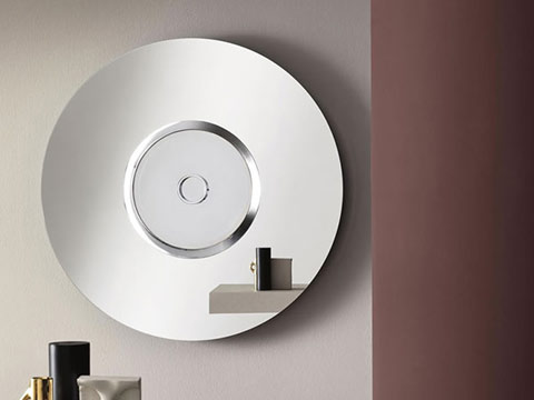 round and concentric wall mirror with central rim in gilded metal