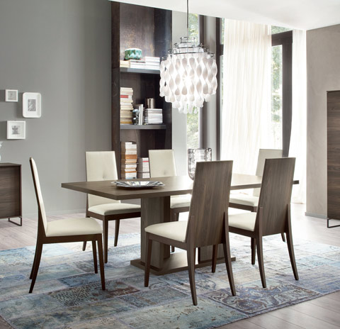 Dining room with modern dining set in gray color. six chairs around the table.