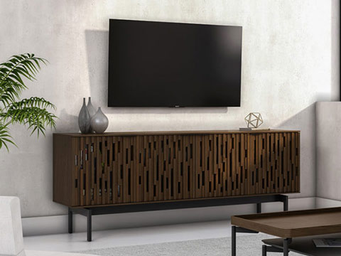 moder storage media credenza in wood color. Big tv mounted on a wall.