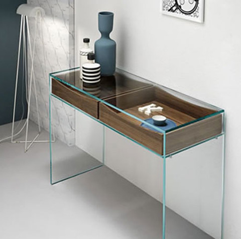 Console table with the glass frame. Two wooden shelves are on the top. You can see different accessories on the top of the table.