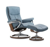 Stressless recliner in light blue color. White background.